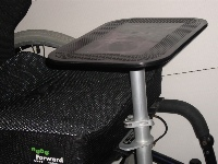 Photo of flat multi-table on wheelchair