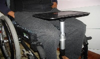 Photo of table top mounted under wheelchair cushion